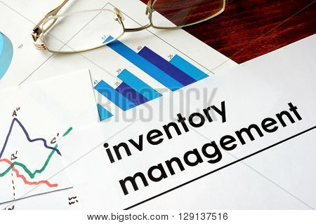 Paper with words inventory management and charts.