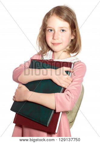 Schoolgirl With Books In Her Hands. Isolated On White.