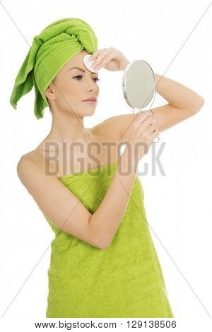 Beautiful woman with cotton pad.