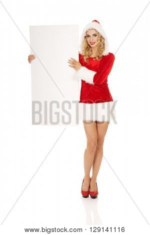 Santa woman holding white empty banner
