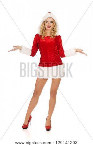 Beautiful santa woman pointing something