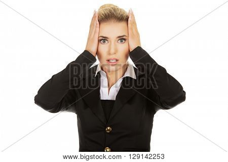Young shocked businesswoman  olding her head in amazement and op