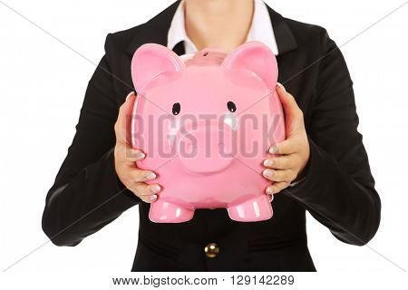 Business woman saving money in piggybank