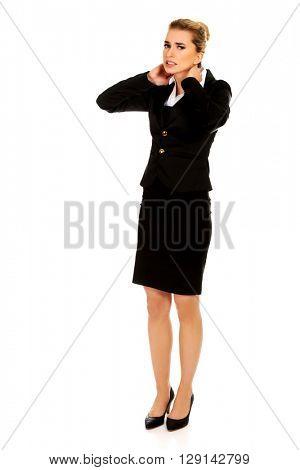 Businesswoman having huge neck ache