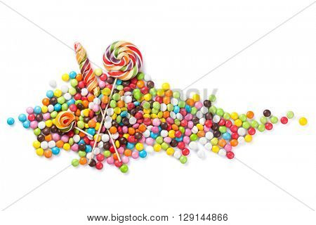 Colorful candies and lollipops. Isolated on white background