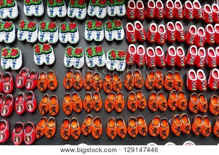 Magnets with dutch traditional wooden shoes or clogs for sale in shop in Netherlands