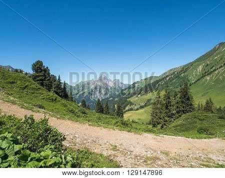 A view of Alpine mountains surrounding the village Schroecken in Bregenzerwald region Vorarlberg Austria