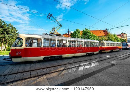 BRATISLAVA, SLOVAKIA - CIRCA APRIL 2016: Old tram with passengers on Kapucinska street in the old town of Bratislava the capital of Slovakia. Transportation in Bratislava old town