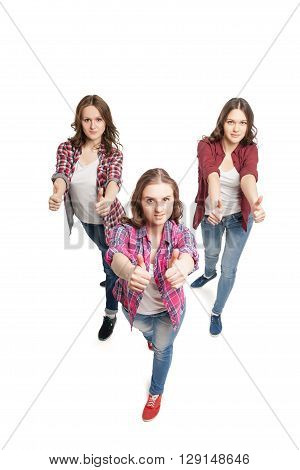 three young beautiful happiness women posing over white background