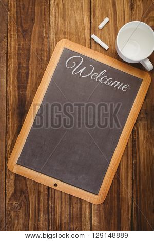 Welcome message against chalkboard on desk
