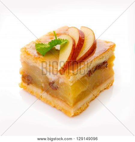 Slice cheesecake with iapples solated on white background.