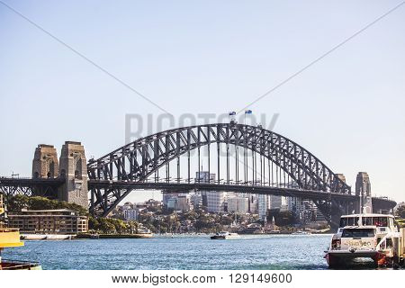 Sydney Australia - May 15 2015: Ferry pulling in to Circular Quay in Sydney Australia with the Harbour Bridge in the background.