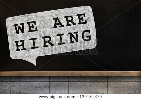 We are hiring message against blackboard on wall