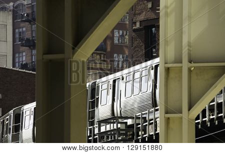 Train Through Chicago, surrounded by buildings and steel.