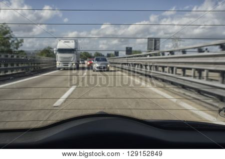 The motorway from the rear window of a car