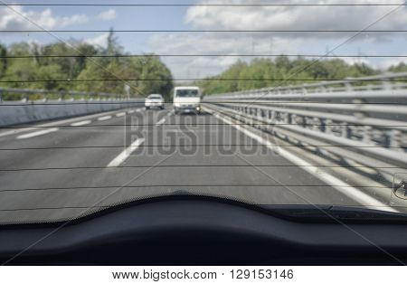 The highway traffic from the rear window