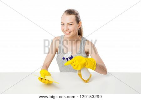 Young woman with wipe or rag and cleansing spray for window, close-up, housewife, isolated on white