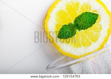 Overturned glass of homemade lemonade with mint.