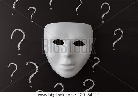 White Mask On Black With Question Marks.
