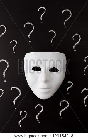 White Mask On Black With Question Marks Vertical