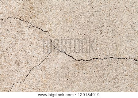 Cracked wall texture. Yellow sand stone with a crack