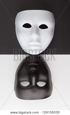 Black And White Masks Upside Down. Personality Change Concept.