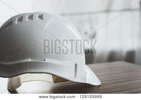 Safety Engineer Helmet Gear on wooden table ** Note: Visible grain at 100%, best at smaller sizes