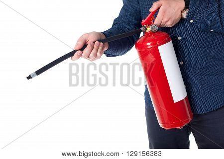 Man using fire extinguisher isolated on white