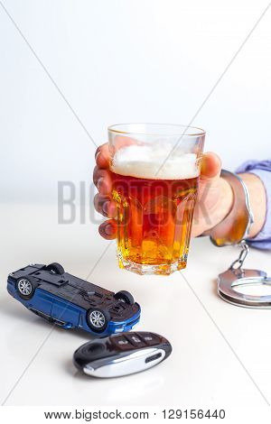 Drunk Driving Concept - Beer Keys and Handcuffs