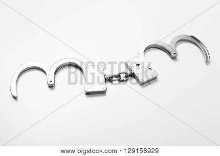 handcuffs isolated in white. justice. top view.