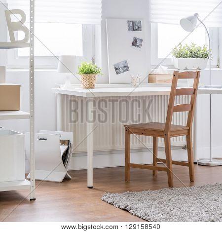 Wooden Chair In White Interior