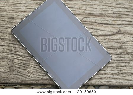 Digital Tablet Device On Wooden Walkway