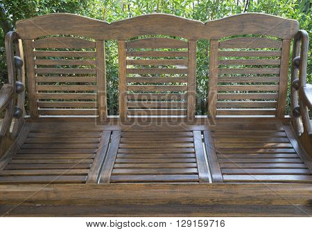 brown wooden bench for resting in garden