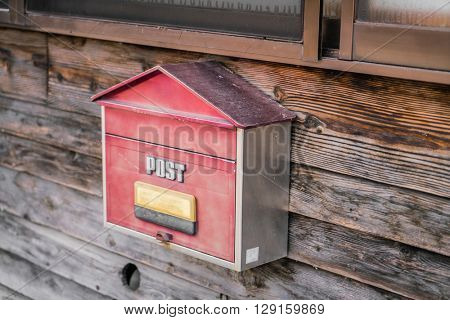 Old wooden mailbox on wood background