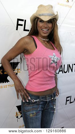 Traci Bingham at the Flaunt Magazine Hosts Antik Denim's Party at the Antik on Melrose Hollywood, USA on August 18, 2005.