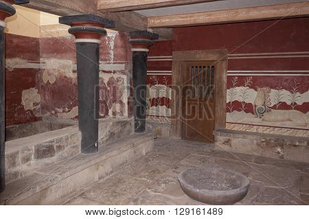 HERAKLION GREECE - AUGUST 1 2013: Restored room in the Palace of Knossos. Ruins of Knossos Palace south of Heraklion - very popular among tourists visiting Crete