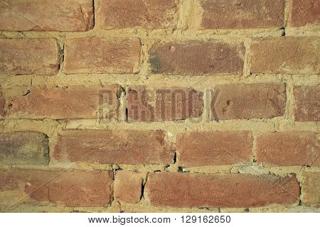 Red brick wall background. Brick wall texture. Brown brick wall background. Concrete texture brick background. Background of brick wall. Brick background. Horizontal architecture wallpaper. Close up.