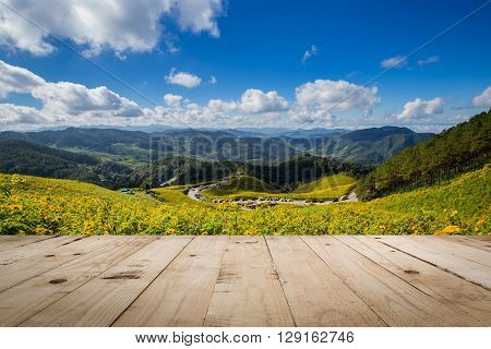 Wood Table And Tung Bua Tong Mexican Sunflower In Maehongson, Thailand
