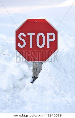 Stop Sign Buried In Snow Drift