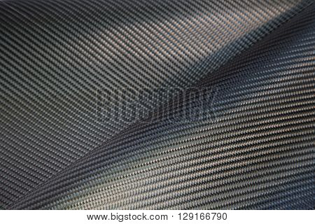 Black woven carbon fiber composite texture for reinforcement car parts.