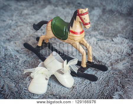 Children's shoes and children's toy rocking horse