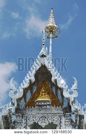 golden Buddha on silver church on sunshine day