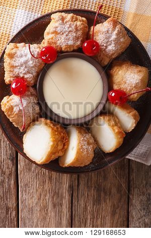 Dessert Leche Frita With Condensed Milk And Cherries Closeup. Vertical Top View
