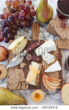 Soft cheese with crackers and fresh fruits