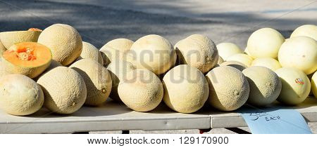 Ripe Cantaloupes for sale at outdoor market place.