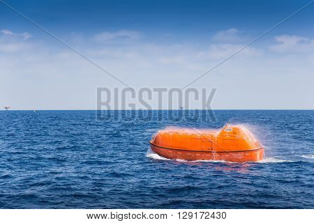rescue boat or life boat at oil and gas platform annual sea trial test for preventive maintenance,this use for escape or evacuate from fire when abandon platform