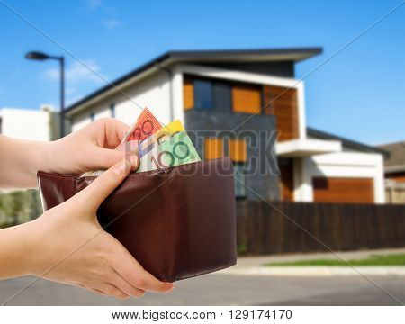 australian money in wallet on real estate background