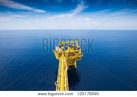 Oil and gas remote wellhead platform near central processing platform