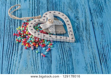 Different Colorful Beads On The Wooden Table