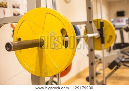 smith machine barbell in fitness room for weight training and muscle building